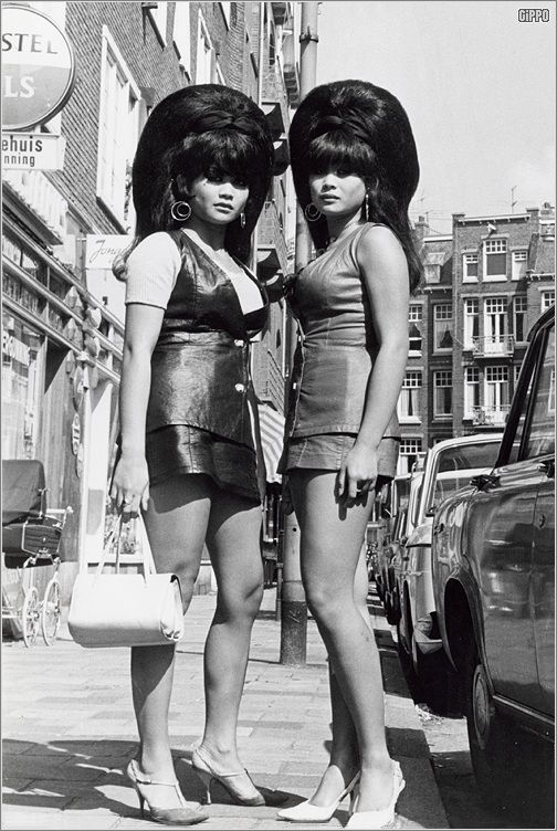 The bigger the hair, the closer to God.....Thai twins with big beehives in Amsterdam in the 60's.